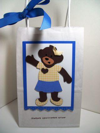 Girl bear on bag